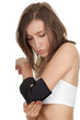 young woman in medical bandage, elbow support