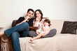 Happy family snacking on sofa couch