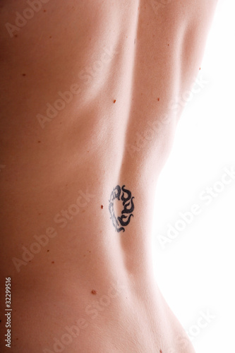 woman with slavonic sun rune tattoo on back