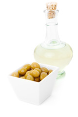 decanter of  oil and olives, isolated on white background