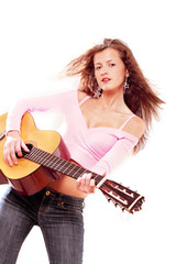 Beautiful girl with guitar in rock n roll style