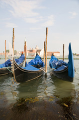 gondolas in Grand Canal Venice Italy famous church in background