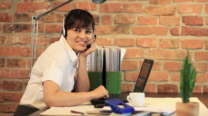Attractive helpdesk consultant smiling to the camera