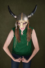 Woman in Viking Helmet Flexes Her Muscles