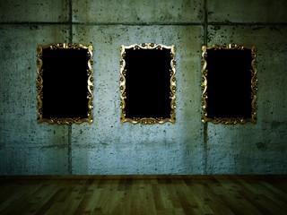 3 goldene Bilderrahmen vor Betonwand