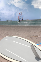 surfboard and surfers windsurfing in a storm