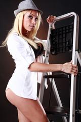 Cute blond sets up a ladder
