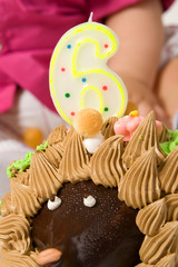 Cake in the form of a hedgehog with the number six