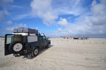 beach of St. Peter Ording with SUV