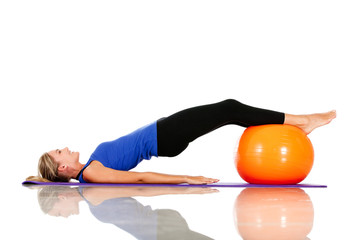 Exercising with pilates ball