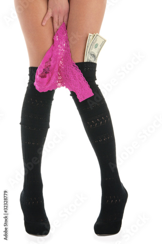 Female legs with panties and money