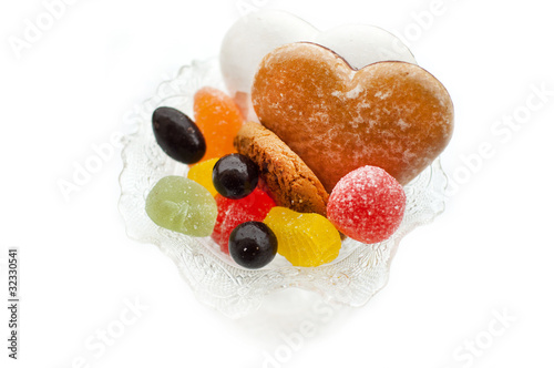 Sweets in a vase. Isolated on white background