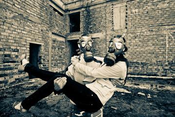 Bizarre portrait of romantic couple with gas masks