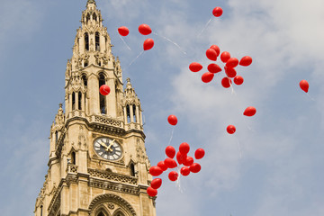 Many red balloons in front of the town hall in Vienna, Austria