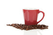 coffee cup and beans over white background