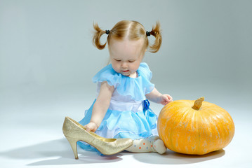 beautiful princess in Cinderella dress with pumpkin