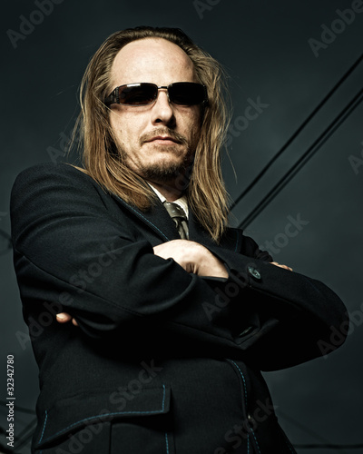 Man in Sunglasses with Arms Crossed