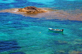 Isolated boat floating on the mediterranean sea