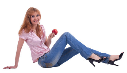 tall mature woman in jeans sit with apple