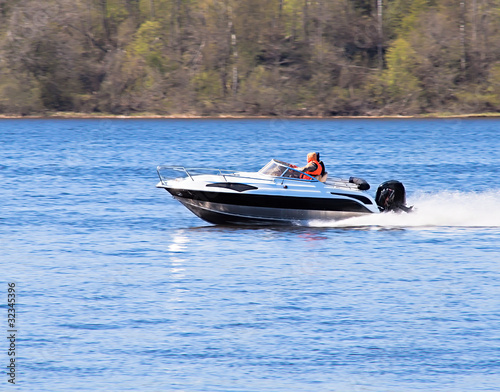motorboat on the river - 32345396