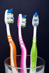 colorful toothbrushes in a glass