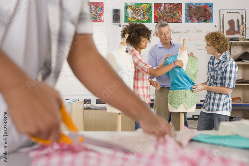 Teacher talking to students in home economics classroom