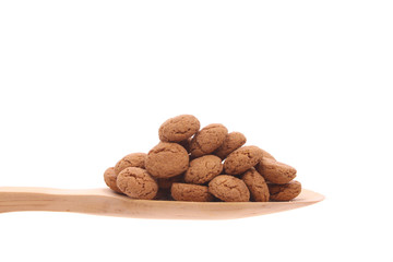 Spice-nuts on a wooden spoon isolated on a white background