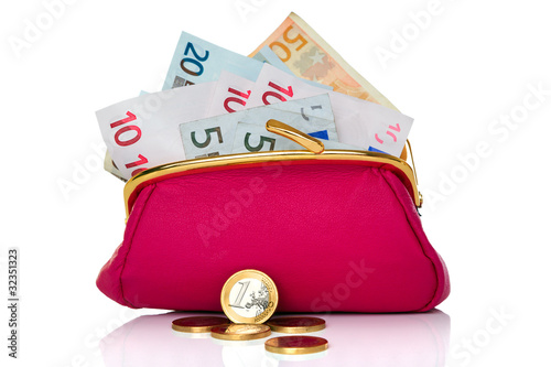 Purse full of money isolated on white