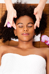 Facial temple massage in beauty spa