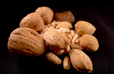 Walnuts,almonds on black