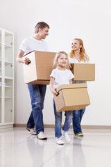 Parents and child with cardboard boxes