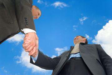 Handshake two businessmen.