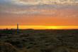 leuchtturm vor einem sonnenuntergang