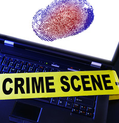 laptop fingerprint with yellow crime scene tape across it