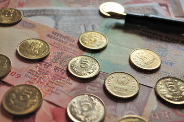 Indian Currency notes and Coins with fountain pen