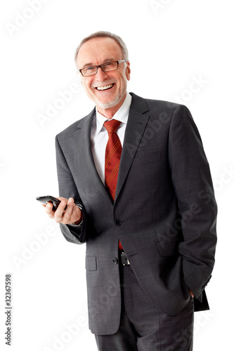 Smiling mature business man with mobilephone