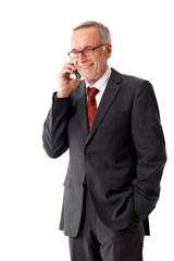 Senior business man with mobilephone und a pair of glasses