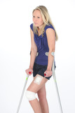 woman with bandage and crutch