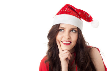 smiling santa girl looking on copyspace - isolated over white
