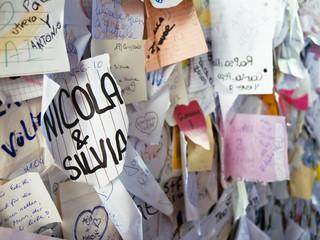 """""""Nicola&Silvia"""", Love notes in archway of Casa di Giulietta."""