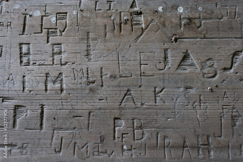 Carved names on pew in old church