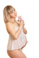Young mother in white lingerie with flower isolated