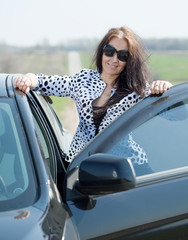 middle age woman with  car