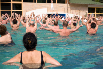Group of gym people in a thermal swimming pool.