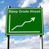 Steep grade sign with rising sales chart