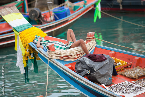 burma fisherman on colorful boat
