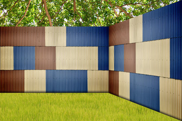 Metal sheet fence in garden