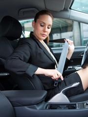 woman puting safety belt on