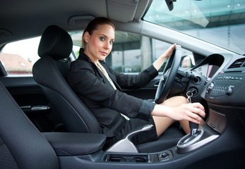 attractive woman driving car