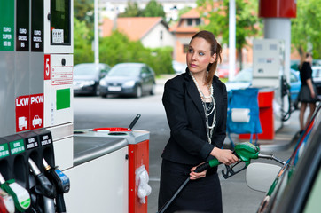 elegant woman in gas station